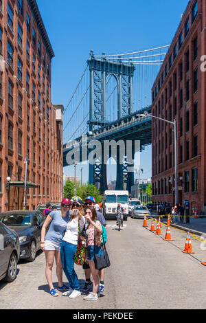 Tourists visiting Dumbo in Brooklyn - Stock Photo