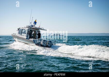 180813-N-WO404-257    BlACK SEA (Aug. 13, 2018) Vice Adm. Lisa M. Franchetti, commander, U.S. 6th Fleet and commander, Naval Striking and Support Forces NATO, left, and Bulgarian Rear Adm. Mitko Petev, Bulgarian Navy chief of naval operations, stand on a Bulgarian Navy patrol boat during a swarming exercise with the Arleigh Burke-class guided-missile destroyer USS Carney (DDG 64) in the Black Sea Aug. 13, 2018. U.S. 6th Fleet, headquartered in Naples, Italy, conducts the full spectrum of joint and naval operations, often in concert with allied and interagency partners, in order to advance U.S. - Stock Photo