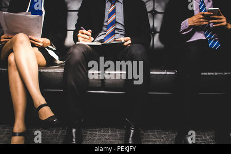 stressful people group sitting and waiting to interview for a job on sofa. - Stock Photo