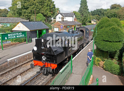 Ivatt 2MTT Class No 41312 at Medstead and Four Marks station with a train from Alresford to Alton on the Watercress Line preserved steam railway  15/0 - Stock Photo