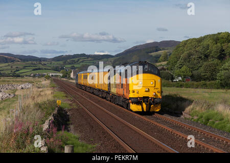 A Colas Railfright class 37 locomotive at Kirkby In Furness on the Cumbrian coast line hauling the Network Rail Plain Line pattern recognition train - Stock Photo