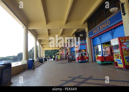 Funfair and shops selling beach gear in the Western Shelter, Whitmore Bay, Barry Island, Wales - Stock Photo