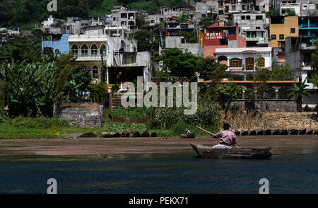 Citizens of near by towns fishing in a canoes in Lake Atitlan, Solola, Guatemala. 14 July 2018 - Stock Photo