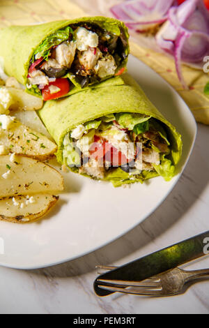 Healthy Greek chicken wrap with herbed potatoes and feta cheese - Stock Photo