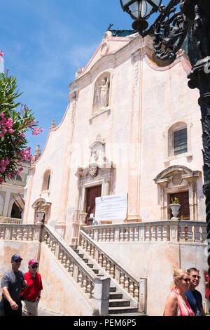 Italy Sicily Monte Tauro famous luxury tourist resort Taormina Church Chiesa di San Giuseppe skull & crossbones statue sculpture under renovation - Stock Photo