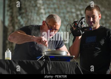 Chef Robert Irvine prepares a meal during his Robert Irvine