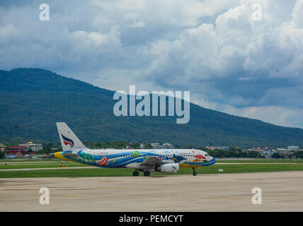 Chiang Mai, Thailand - Jun 22, 2016. An Airbus A320 airplane of Bangkok Air taxiing on runway of Chiang Mai Airport (CNX). - Stock Photo