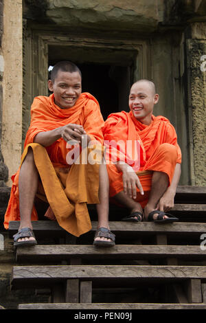 Siem Riep, Cambodia / Oct 9, 2011: Monks Sitting On Steps of Angkor Wat, Cambodia - Stock Photo