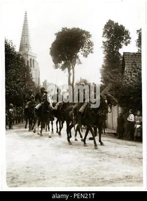 Indian cavalry marching through a French village [Estr u00e9e Blanche]. Photographer  H. D. Girdwood. - Stock Photo