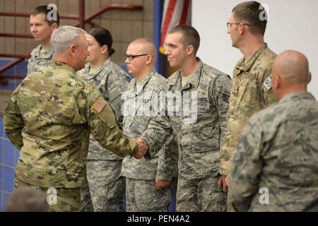 U.S. Army Gen. Frank Grass, chief of the National Guard Bureau, left, shakes hands and congratulates Staff Sgt. Luke Knutson, of the 119th Civil Engineer Squadron, as Grass meets with members of the North Dakota Army and Air National Guard at a town Hall style briefing at the Raymond J. Bohn Armory, Bismarck, N.D., Dec. 12, 2015. (U.S. Air National Guard photo by Senior Master Sgt. David H Lipp/Released) - Stock Photo
