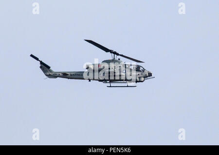 An AH-1W Super Cobra with the Marine Aircraft Group 49, a United States Marine Corps Reserve aviation unit based at Joint Base McGuire-Dix-Lakehurst, N.J., performs maneuvers Dec. 13, 2015. The Super Cobra provides close air support, armed escort and armed reconnaissance for the U.S. Marine Corps. The AH-1W is a twin-engine attack helicopter, which has been in service with the Marines since 1986. (U.S. Air National Guard photo by Master Sgt. Mark C. Olsen) (This image was cropped to focus on the subject of the image) - Stock Photo