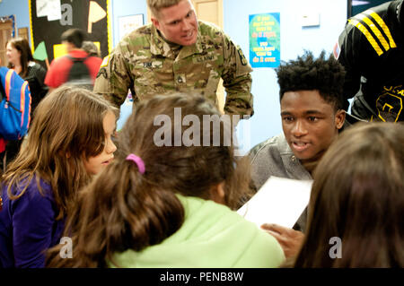 Team East defensive back Trayvon Mullen (right), Coconut Creek High School in Coconut Creek, Fla., and Sgt. 1st Class Andrew Fink, the 2016 Army Noncommissioned Officer of the Year, try to stump the students during a math game Tuesday, Jan. 5 at Boysville in San Antonio, Texas. Soldiers and the nation's top high school football players are visiting locations like Boysville, a program for children from abused and neglected homes, as part a way to give back to the community leading up to the 2016 Army All-American Bowl, which takes place Saturday, Jan. 9 at the Alamo Bowl in downtown San Antonio - Stock Photo