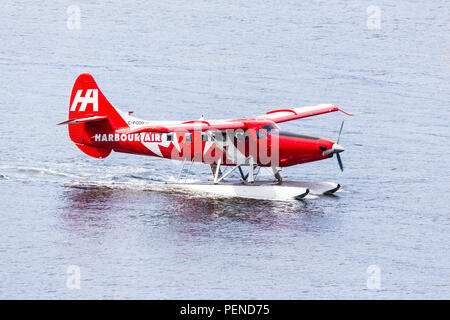 Seaplane C-FODH, a De Havilland DHC-3T Vazar Turbine Otter, taking tourists for a pleasure flight from the harbour at Vancouver, British Columbia, Can - Stock Photo