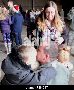 Members of the 171st Air Refueling Wing reunite with their families after returning from a deployment on Dec. 6, 2015. (Air National Guard photo by Staff Sgt. Ryan A. Conley) - Stock Photo
