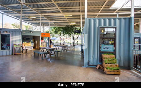 Johannesburg, South Africa, 5 May - 2018: Shops made from used shipping containers. - Stock Photo
