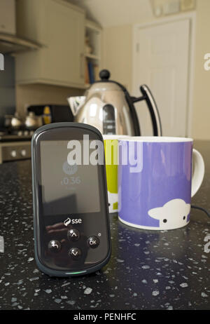SSE smart meter on kitchen worktop England UK United Kingdom GB Great Britain - Stock Photo