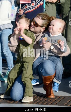 """151217-N-WX580-042 CORONADO, Calif. (Dec. 17, 2015) Family and friends of Sailors assigned to the """"Black Knights' of Helicopter Sea Combat Squadron (HSC) 4, celebrate the unit's homecoming at Naval Air Station North Island. HSC 4 returned to San Diego following a four-month deployment with Carrier Air Wing 2. (U.S. Navy photo by Mass Communication Specialist 2nd Class La'Cordrick Wilson/Released) - Stock Photo"""