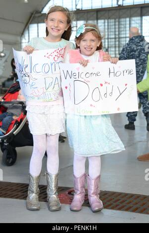 """151217-N-WX580-022 CORONADO, Calif. (Dec. 17, 2015) Family and friends of Sailors assigned to the """"Black Knights' of Helicopter Sea Combat Squadron (HSC) 4, celebrate the unit's homecoming at Naval Air Station North Island. HSC 4 returned to San Diego following a four-month deployment with Carrier Air Wing 2. (U.S. Navy photo by Mass Communication Specialist 2nd Class La'Cordrick Wilson/Released) - Stock Photo"""