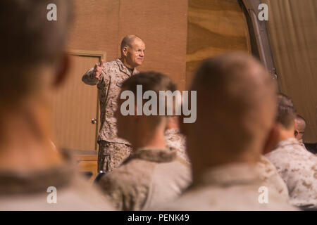 U.S. Marine Corps General Robert B. Neller, 37th Commandant of the Marine Corps, addresses the Marines and sailors of Special Purpose Marine Air-Ground Task Force-Crisis Response-Central Command (SPMAGTF-CR-CC), at an undisclosed location in Southwest Asia, Dec. 22, 2015. SPMAGTF-CR-CC is deployed with a crisis response mission spanning 20 nations of U.S. Central Command. (U.S. Marine Corps photo by Lance Cpl. Clarence A. Leake/Released) - Stock Photo