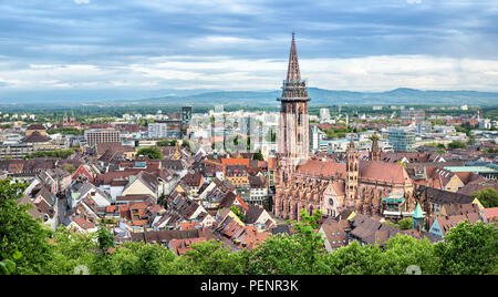 Aerial panorama of Freiburg im Breisgau with Cathedral on foreground, Germany - Stock Photo