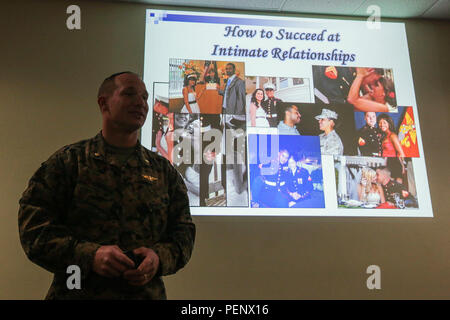 """Navy Lieutenant Commander Aaron Kleinman presents a class titled """"How to Succeed at Intimate Relationships"""" at Marine Corps Base Camp Pendleton, Calif., Jan. 12, 2016. The class was part of the iRelate program designed to encourage healthier relationships, decrease divorce rates and improve unit readiness by allowing Marines to make informed decisions about relationships. Kleinman, from Norfolk, Va., is the chaplain for Assault Amphibian School Battalion, School of Infantry – West. (U.S. Marine Corps photo by Lance Cpl. Caitlin Bevel) - Stock Photo"""