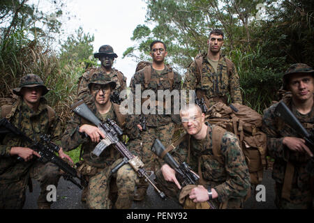 Sgt. Chad Nillo, top row, center, poses for a photo with his squad on Camp Hansen, Okinawa, Japan, Jan. 9, 2016. Sgt. Nillo is currently assigned to Alpha Company, Battalion Landing Team 1st Battalion, 5th Marines, 31st Marine Expeditionary Unit. Nillo has served with Alpha Co., BLT 1/5, 31st MEU, for the past 10 months and has had a great impact on the unit. Nillo is from Newark, California. (U.S. Marine Corps photo by Lance Cpl. Carl King Jr./Released)