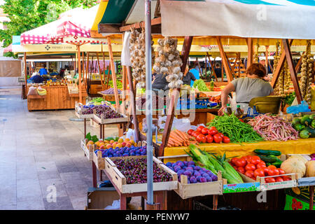 Zadar - July 3 2018: Local producers and merchants offering fresh local grown fruits and vegetables on the market. Due good climate conditions a varie - Stock Photo
