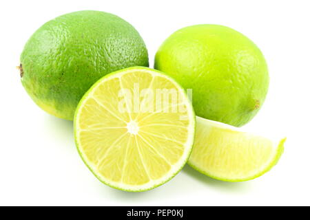 composition of fresh lime fruits isolated on a white background - Stock Photo