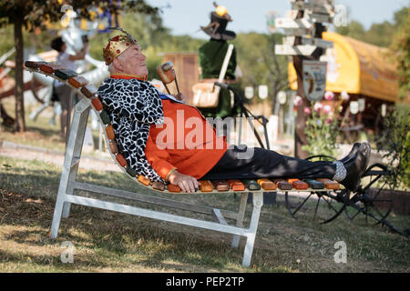 Holzhausen, Germany. 16th Aug, 2018. Gerhard Herbst, former King of Bratwurst, enjoys the view from a new lounger at the Bratwurst Museum. Fans of this Thuringian speciality intend to celebrate the 'International Day of the Bratwurst' with new attractions in the Bratwurst Museum every year from today onwards. Credit: Arifoto Ug/Michael Reichel/dpa-Zentralbild/dpa/Alamy Live News - Stock Photo