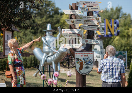 Holzhausen, Germany. 16th Aug, 2018. Visitors to the Bratwurstmuseum examine signposts showing the way to Bratwurst specialities in other regions. Fans of this Thuringian speciality intend to celebrate the 'International Day of the Bratwurst' with new attractions in the Bratwurst Museum every year from today onwards. Credit: Arifoto Ug/Michael Reichel/dpa-Zentralbild/dpa/Alamy Live News - Stock Photo
