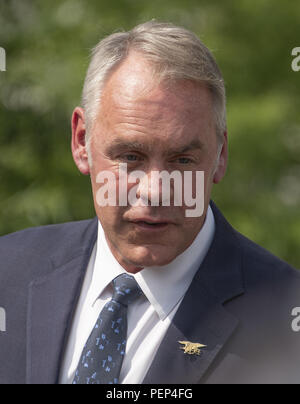 Washington, District of Columbia, USA. 16th Aug, 2018. United States Secretary of the Interior Ryan Zinke meets reporters at the White House in Washington, DC prior to attending a cabinet meeting with US President Donald J. Trump on Thursday, August 16, 2018.Credit: Ron Sachs/CNP Credit: Ron Sachs/CNP/ZUMA Wire/Alamy Live News - Stock Photo