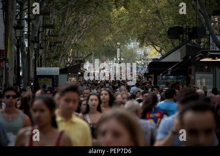 Barcelona, Catalonia, Spain. 16th Aug, 2018. People walk Las Ramblas of Barcelona one day before the anniversary of last year's terror attacks wich killed 16 people and injured more than 120 when two vehicles crashed into the crowds. Credit: Jordi Boixareu/ZUMA Wire/Alamy Live News - Stock Photo
