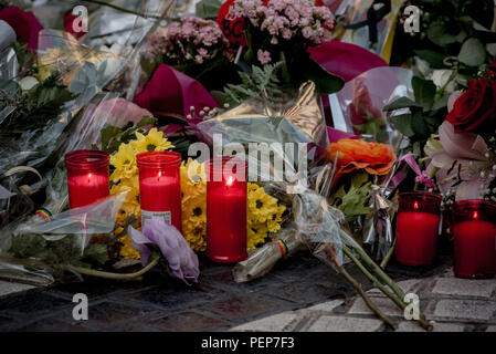 Barcelona, Catalonia, Spain. 16th Aug, 2018. Candles and flowers are placed on the ground of Las Ramblas in Barcelona to pay tribute to the victims of last year's terror attacks wich killed 16 people and injured more than 120 when two vehicles crashed into the crowds. Credit: Jordi Boixareu/ZUMA Wire/Alamy Live News - Stock Photo