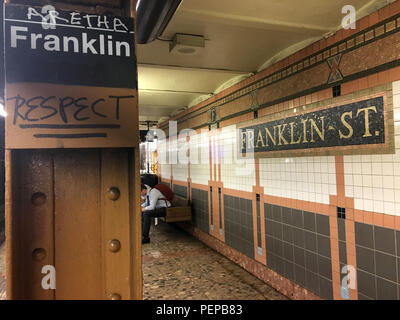 New York, USA. 16th Aug, 2018. 'Aretha' stands above a sign in the subway station 'Franklin Street'. New York fans of Aretha Franklin have created a very special souvenir for the late soul singer. They decorated the subway station 'Franklin Street' in the south of Manhattan with pens and stickers in memory of the singer. The station is actually named after Benjamin Franklin, one of the founding fathers of the USA. The musician Aretha Franklin died of pancreatic cancer at the age of 76 on Thursday. Credit: Christina Horsten/dpa/Alamy Live News - Stock Photo