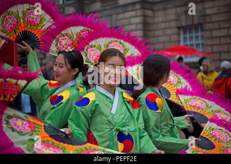 Edinburgh, Scotland, UK 17 August 2018. Edinburgh Fringe Royal Mile adding colour to the High Street Members of Soon Chun Hyang Uni English Drama Club promote their joyful and never too serious The Merry Wives of Seoul as a new adaptation of The Merry Wives of Windsor, Shakespeare's comedy of love and marriage. - Stock Photo