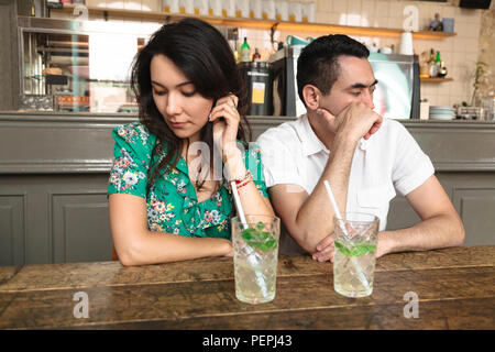 Young couple turned away from each other - Stock Photo