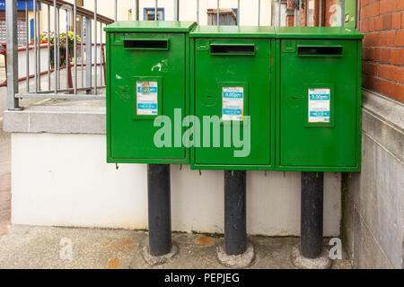 Irish post boxes painted green. - Stock Photo