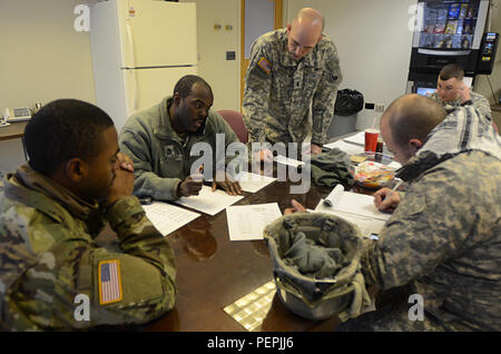 Virginia National Guard Soldiers assigned to the Fredericksburg-based 116th Brigade Special Troops Battalion, 116th Infantry Brigade Combat Team, coordinate with the Virginia State Police to be ready for possible winter weather response operations Jan. 22, 2016, in Fairfax, Va. The Virginia National Guard has approximately 400 personnel staged and ready at National Guard readiness centers along the I-81 corridor between Lexington and Winchester, along the Route 29 corridor from Warrenton to Danville, as well as in areas near Richmond, Fredericksburg and Gate City. - Stock Photo