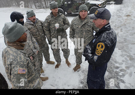 Virginia National Guard Soldiers assigned to the Fredericksburg-based 116th Brigade Special Troops Battalion, 116th Infantry Brigade Combat Team coordinate with the Virginia State Police to be ready for possible winter weather response operations Jan. 22, 2016, in Fairfax, Va. The Virginia National Guard has approximately 400 personnel staged and ready at National Guard readiness centers along the I-81 corridor between Lexington and Winchester, along the Route 29 corridor from Warrenton to Danville, as well as in areas near Richmond, Fredericksburg and Gate City. - Stock Photo