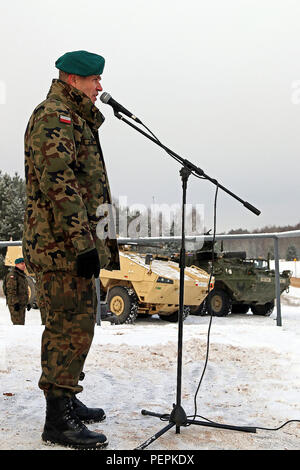 Brig. Gen. Dariusz Gorniak, commander of 12th Mechanized Brigade, Polish Army, gives his opening remarks during an opening of training ceremony recognizing the partnership between his unit and 3rd Squadron, 2nd Cavalry Regiment, Jan. 18, at Konotop, Poland. Following the ceremony, 3-2 Cavalry Soldiers conducted squad-level training alongside Polish allies in support of Operation Atlantic Resolve, a multinational demonstration of continued U.S. commitment to the collective security of North Atlantic Treaty Organization allies. (U.S. Army photo by Sgt. Paige Behringer, 10th Press Camp Headquarte - Stock Photo