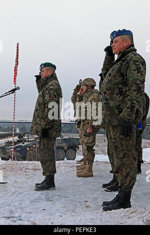 Brig. Gen. Dariusz Gorniak (left), commander of 12th Mechanized Brigade, Polish army, salutes soldiers of K Troop, 3rd Squadron, 2nd Cavalry Regiment, during pass and review concluding an opening of training ceremony recognizing the partnership between the two units and nations, Jan. 18, at Konotop, Poland. Following the ceremony, 3-2 Cavalry Soldiers conducted squad-level training alongside Polish allies in support of Operation Atlantic Resolve, a multinational demonstration of continued U.S. commitment to the collective security of North Atlantic Treaty Organization allies. (U.S. Army photo  - Stock Photo