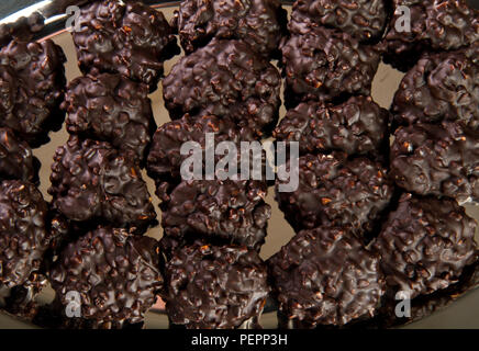Chocolate cookies on a metal tray - Stock Photo