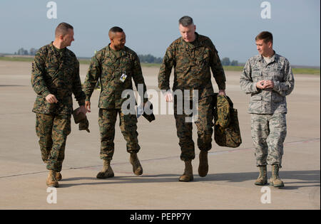 Colonel Martin F. Wetterauer III (left), Col. Calvert L. Worth Jr (center), and Lt. Col. John Preston (right), greet U.S. Marine Corps Maj. Gen. Niel E. Nelson, commander of U.S. Marine Corps Forces Europe and Africa, at Morón Air Base, Spain, Jan. 25, 2016. Nelson visited Morón to attend the transfer of authority between Special-Purpose Marine Air-Ground Task Force Crisis Response-Africa. (U.S. Marine Corps Photo by Sgt. Kassie L. McDole/Released) - Stock Photo