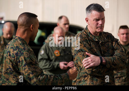 U.S. Marine Corps Col. Calvert L. Worth Jr., (left) commanding officer of Special Purpose Marine Air Ground Task Force Crisis Response Africa, discusses the challenges of space at Morón Air Base, Spain, with U.S. Marine Maj. Gen. Niel E. Nelson, Commander of U.S. Marine Corps Forces Europe and Africa, Jan. 25, 2016. Nelson visited Morón to attend the transfer of authority between Special-Purpose Marine Air-Ground Task Force Crisis Response-Africa. (U.S. Marine Corps Photo by Sgt. Kassie L. McDole) - Stock Photo