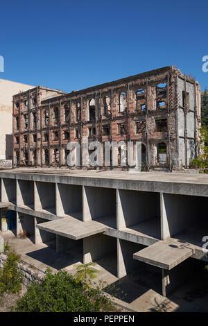 The ruins of the Hotel Neretva, nicknamed 'Tito's palace', at Mostar, Bosnia and Herzegovina. - Stock Photo