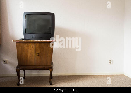 Vintage Television on wooden antique closet, old design - Stock Photo