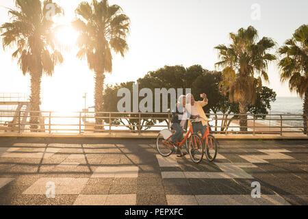 Senior couple taking selfie at promenade - Stock Photo
