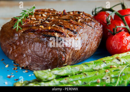 beef steak grilled with asparagus tomatoes spice on plate - Stock Photo