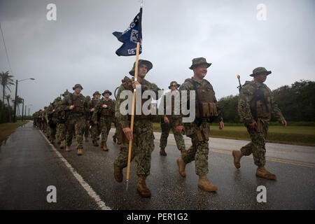 Sailors, assigned to Coastal Riverine Group ONE Detachment Guam (CRG-1 Det Guam), conduct a 6-mile command force march at Naval Base Guam Jan. 29, 2016. CRG-1 is assigned to Commander, Task Force (CTF) 75, the primary expeditionary task force responsible for the planning and execution of coastal riverine operations, explosive ordnance disposal, diving engineering and construction and underwater construction in the U.S. 7th Fleet area of responsibility. (U.S. Navy Combat Camera photo by Petty Officer 1st Class Ace Rheaume/RELEASED) - Stock Photo