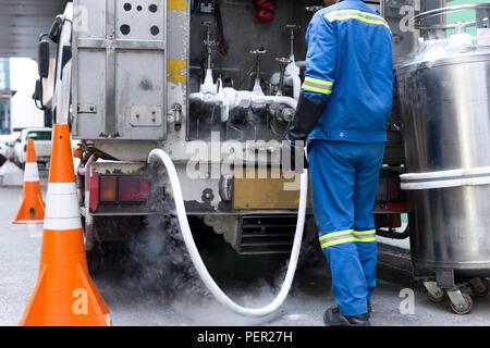 Technician fill with liquid nitrogen with Nitrogen storage tank from a van. - Stock Photo